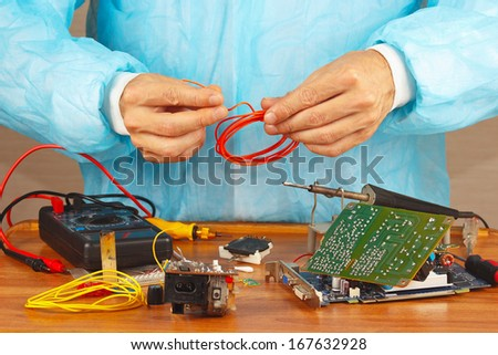 Maintenance of electronic hardware in the service workshop - stock photo