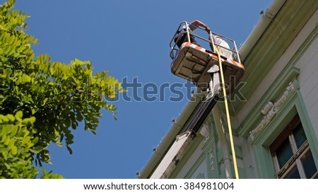 Maintenance Workers In The Bucket of Mobile Crane. - stock photo