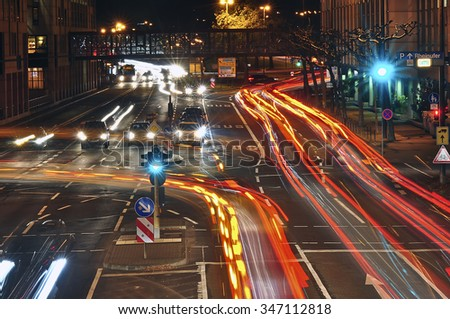MAINZ, GERMANY - DEC 03: Car light trails on the street at night on December 03, 2015 in Mainz, Germany. - stock photo