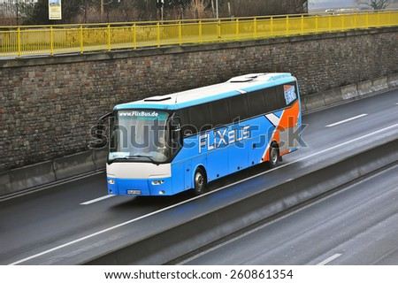 MAINZ,GERMANY-FEB 22:blue FLIXbus on the highway on February 22,2015 in Mainz,Germany. FLIXbus offer a cheap intercity bus service to more than 120 destinations across Europe. - stock photo