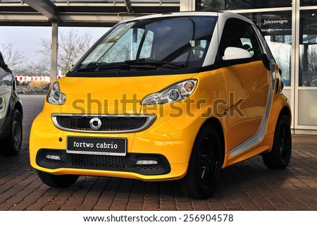 MAINZ,GERMANY-FEB 20:yellow Smart Car on February 20,2015 in Mainz, Germany.Smart Automobile is a division of Daimler AG that manufactures and markets the Smart Fortwo. - stock photo