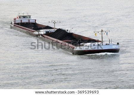 MAINZ, GERMANY - JAN 28: barge ROMAN II with coal on the Rhine  on January 28, 2016 in Mainz, Germany.