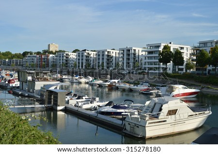 Mainz, Germany - July 20, 2015 - Living in german cities gets more expensive while new luxury apartments with marina are build on river rhine in Mainz Germany