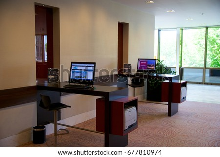MAINZ, GERMANY - JUN 25th, 2017: Business Center with Computer Internet Printer Service, two PC in a luxury Hilton Hotel