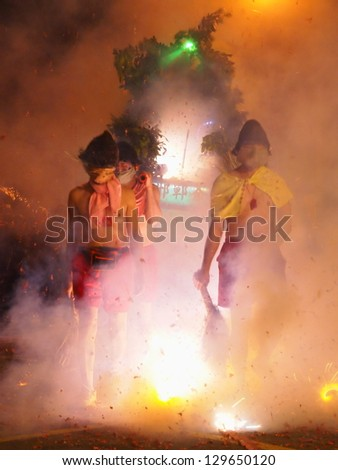 MAIOLI, TAIWAN-FEB. 22: The Bombing Lord Handan is hosted at the Lantern Festival in Maioli, Taiwan on February 24, 2013.  This custom for the Lantern Festival is also held in Taidong, Taiwan. - stock photo