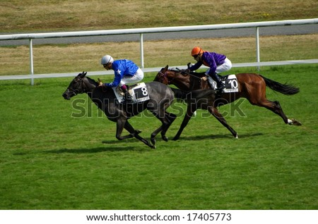 MAISONS-LAFFITTE - JULY 27: horses near the finish line in a horse race in Maisons-Laffitte, France on July 27, 2008