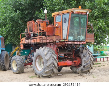 Maize grain collector. Agricultural machinery. Parking of agricultural machinery.                                - stock photo