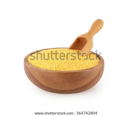 maize grits in wooden bowl with scoop - stock photo