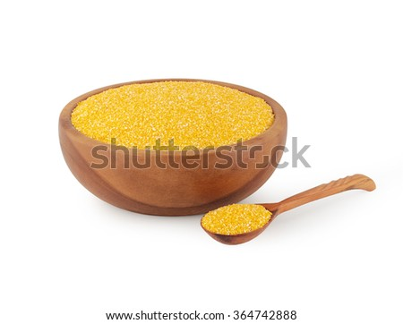 maize grits in wooden kitchen utensils - stock photo