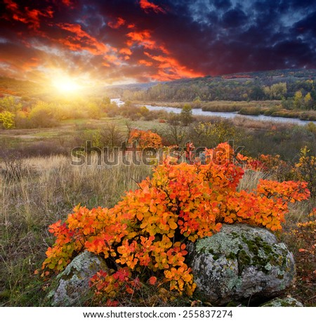 Majestic autumn sunset over river valley - stock photo