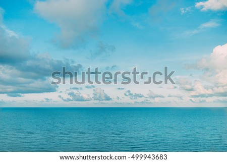 Majestic beautiful white clouds and the calm azure sea background wallpaper. Sunny summer day. Holiday vacation concept. Copy space.