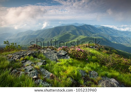 Majestic Blue Ridge Mountain Landscape on the Grassy Ridge spur trail off the Appalachian Trail along the state borders of Western North Carolina and Eastern Tennessee - stock photo