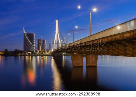 Majestic bridge to downtown and business center of Riga at night time