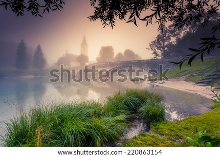 Majestic colorful foggy scene on the lake in Triglav national park, located in the Bohinj Valley of the Julian Alps. Dramatic view. Instagram effect, retro filter. Slovenia, Europe. Beauty world. - stock photo