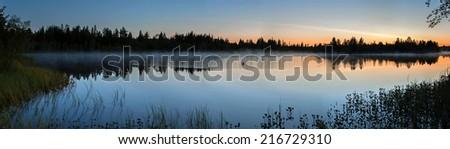 Majestic foggy sunrise in Finland - stock photo