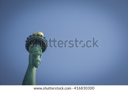Majestic iconic lady liberty statue of liberty in New York harbor welcoming new arrivals - stock photo