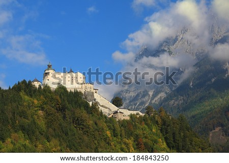 Majestic medieval fortress-palace Hohenwerfen in Austria. The castle is situated on top of the mountain and surrounded by dense forest