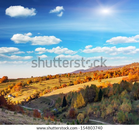 Majestic morning mountain landscape with colorful forest and blue sky. Autumn leaves. Carpathian, Ukraine, Europe. Beauty world. - stock photo