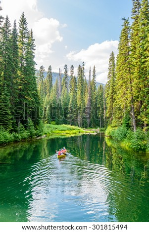 Majestic mountain lake in Canada. Lightning Lake in Manning Park in British Columbia. Boat. - stock photo