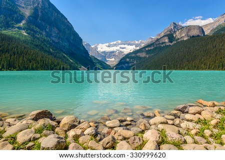 Majestic mountain lake in Canada. Louise Lake view in Banff, Alberta, Canada. Rocky Mountains. - stock photo