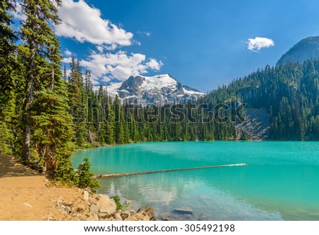 Majestic mountain lake in Canada. Upper Joffre Lake Trail View. - stock photo