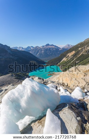 Majestic mountain lake with turquoise water in Canada, glacier as a foreground, view from the top - stock photo