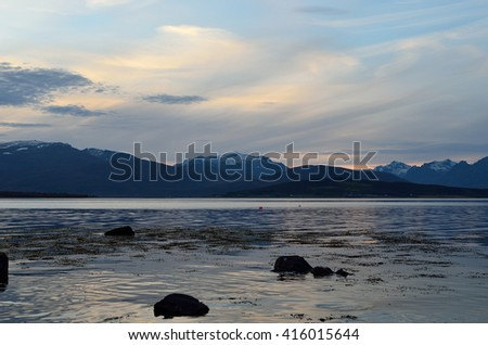majestic mountain landscape and blue fjord in late autumn