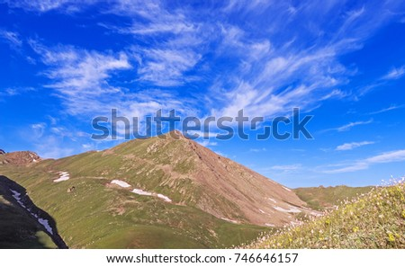 Majestic mountain landscape with spectacular clouds at the summer season.