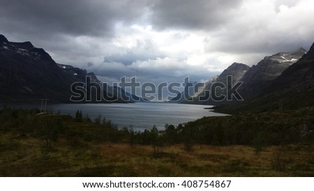 majestic mountain valley with ford in northern Norway