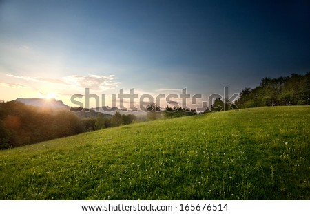 Majestic mountains landscape under morning sky with clouds.