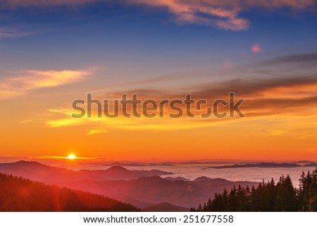 Majestic mountains landscape under morning sky with clouds - stock photo