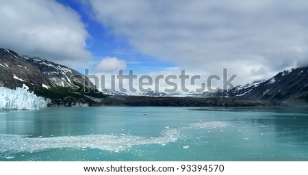 Majestic mountains with reflection in an ocean or lake.  Glacier Bay Alaska - stock photo