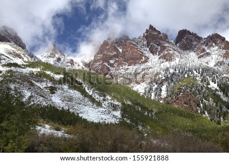 Majestic Show Covered Mountain with Green Trees - stock photo