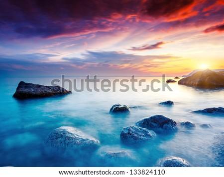 Majestic summer sunset over the sea. Dramatic overcast sky. Crimea, Ukraine, Europe. Beauty world. - stock photo
