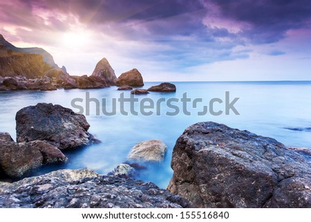 Majestic summer sunset over the sea. Dramatic overcast sky with colorful cloud. Crimea, Ukraine, Europe. Beauty world.
