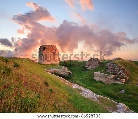 Majestic summer sunset view of ancient Crimean fortress (near Sevastopol Town, Crimea, Ukraine). Composite photo with considerable depth of sharpness. - stock photo