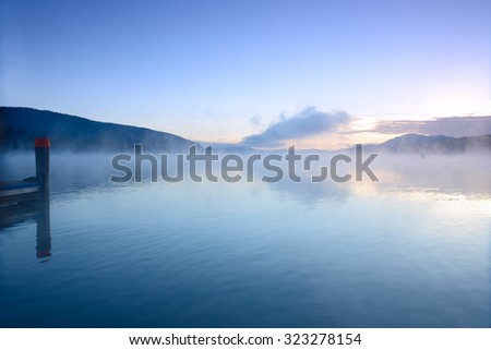 majestic sunrise above lake Worth  (Worthersee). Austria. - stock photo