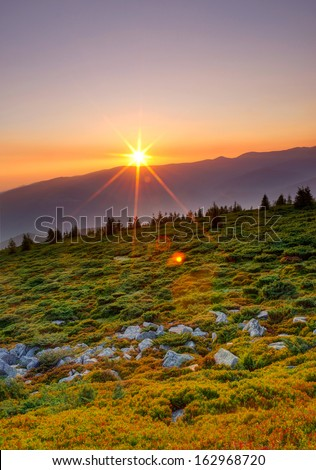 Majestic sunrise in the mountains.  - stock photo