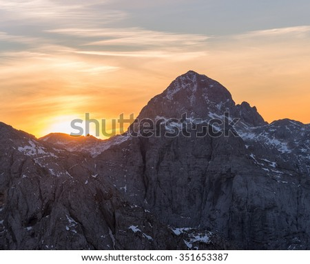 Majestic sunrise in the mountains. Vivid colors in the early morning in Julian Alps