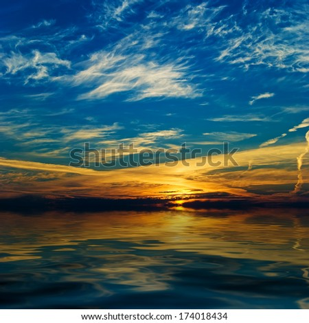 Majestic sunrise over the water - stock photo
