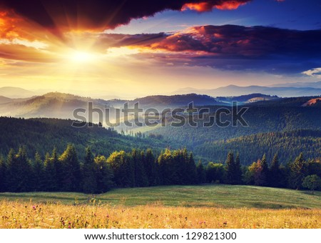 Majestic sunset in the mountains landscape. Dramatic sky. Carpathian, Ukraine, Europe. - stock photo