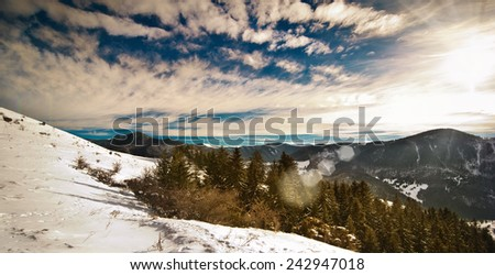 Majestic sunset in the mountains landscape. Sunset landscape in Carpathian mountains. Dawn in mountains Carpathians, Romania. Mountains covered with snow - stock photo