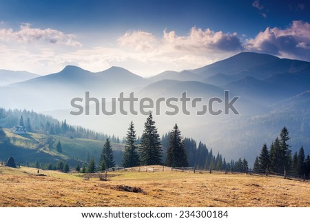 Majestic sunset in the mountains landscape with sunny beams. Dramatic scene. Carpathian, Ukraine, Europe. Beauty world. - stock photo