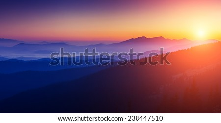 Majestic sunset in the mountains landscape with sunny beams. Dramatic scene. Carpathian, Ukraine, Europe. Beauty world. Retro style, vintage filter. Instagram toning effect. - stock photo