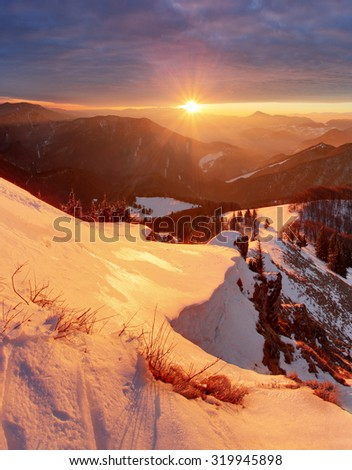 Majestic sunset in the winter mountains landscape. Dramatic sky - stock photo