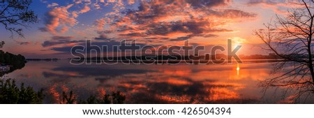 majestic sunset over lake . multicolored clouds reflected in the water. dramatic scene. wonderful landscape. color in nature. beauty in the world