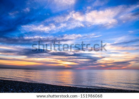 Majestic sunset over the Black Sea in Batumi, Georgia  - stock photo