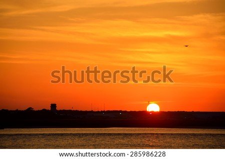 Majestic sunset over the river with airport behind at Florida, USA. - stock photo