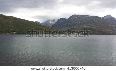 majestic vibrant fjord and mountain landscape in summertime