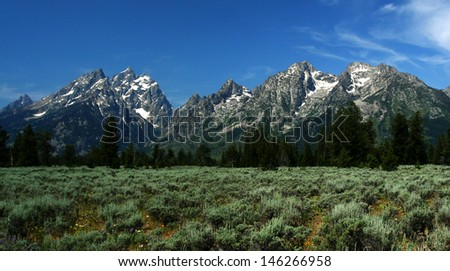 Majestic view of Grand Tetons Mountains on a clear blue summer day.